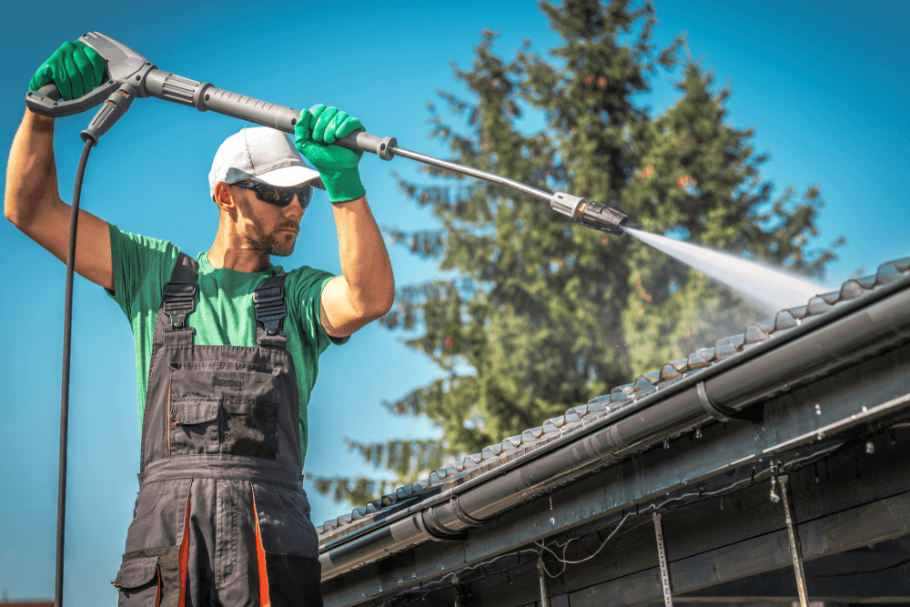 An electric pressure washer is an efficient tool when cleaning the outside gutters of your home.